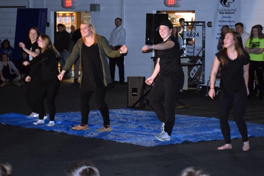 Senior Jayce Bogen and friends performing her skit during the Snow Week Pepfest