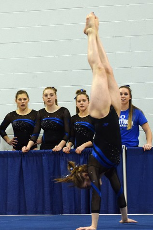 Becca Olson performs her floor routine.