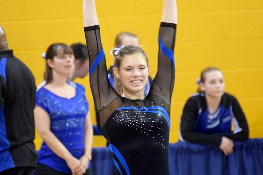 Steph Kretlow smiles at the judges before her vault. Kretlow took second place in the individual vault competition