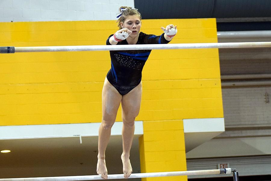 Steph Kretlow competes on the uneven bars