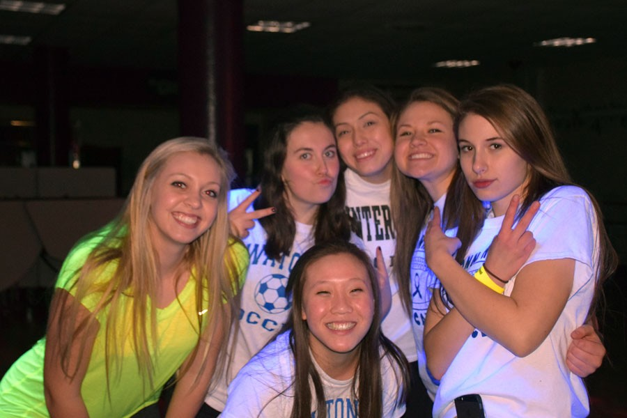 OHS girls posing for a picture at the Blacklight Dance