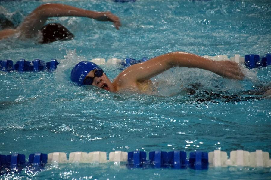 Seventh Grader Trace Walderson swimming in his meet