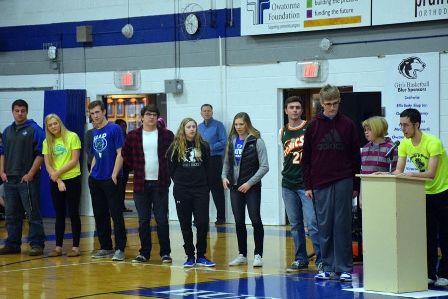 Owatonna 2016 sports captains giving speeches about their team