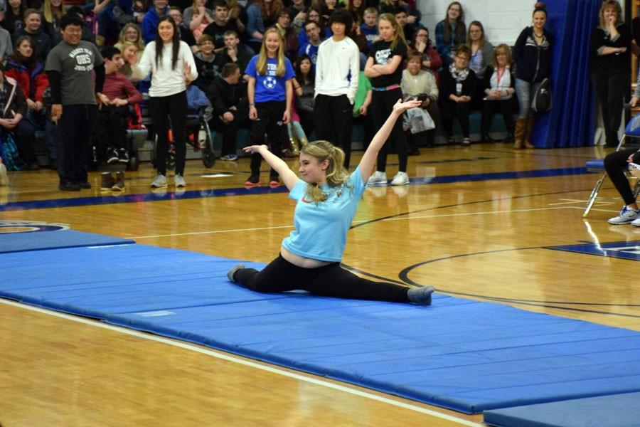 Junior Jenna McMains doing the splits during the pepfest