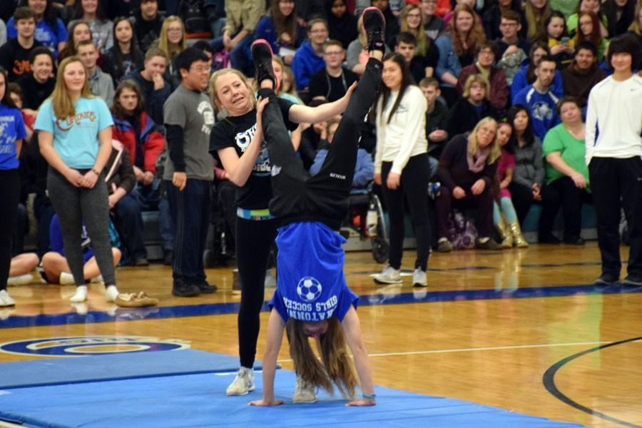 Freshman students doing a handstand during the pepfest