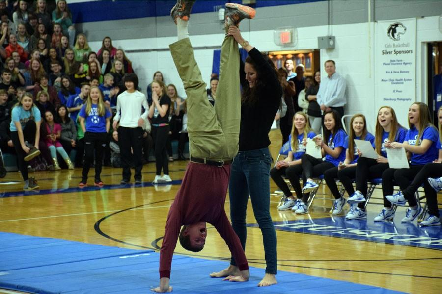 Teachers Mrs. Oien and Mr. Nelson doing a handstand during the pepfest