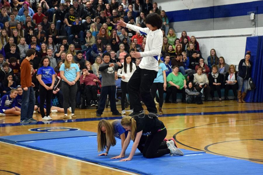 Freshman students doing their gymnastics stunt during the pepfest