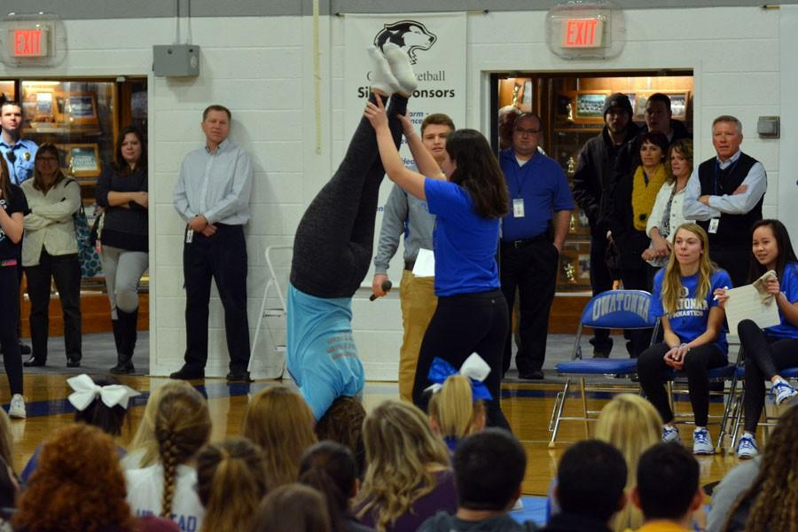 Seniors Kayla Johnson and Cienna Raden attempting a handstand