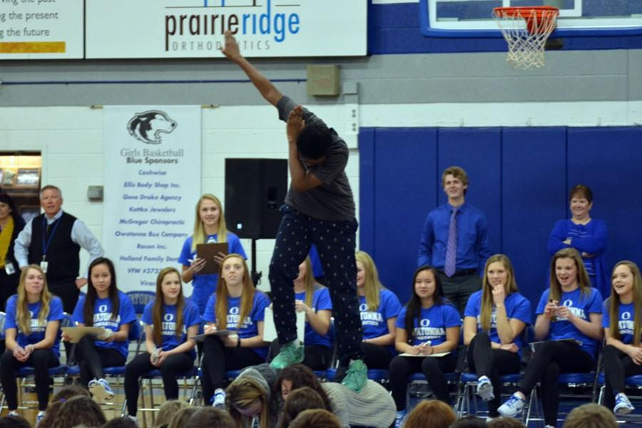 Sophomore students performing their gymnastics stunt