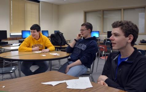Seniors Jordan Julian, Brandon Peeters, and Nelson Jourdan listen to a question at Knowledge Bowl practice