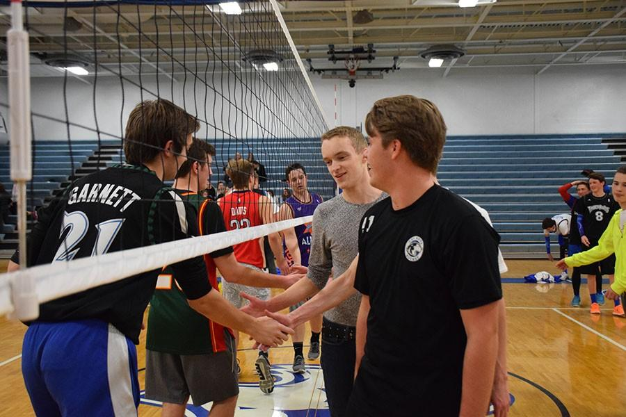 Team Dad and Team Blue shake hands after a hard fought match