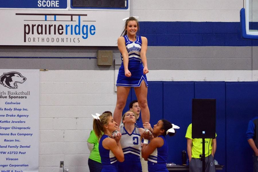 Sophomore Angela Wishy performing her stunt during the pepfest