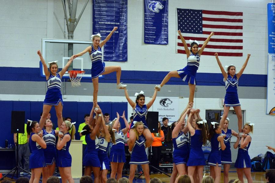 Owatonna Cheerleaders performing their final stunt during the pepfest