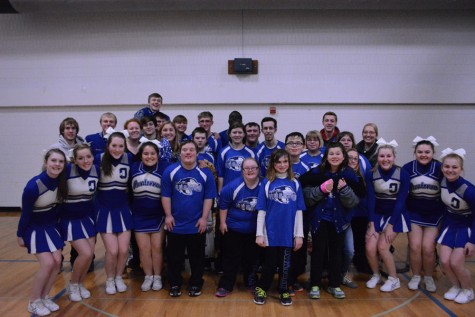 The Adaptive Floor Hockey team and the OHS student section and cheerleaders