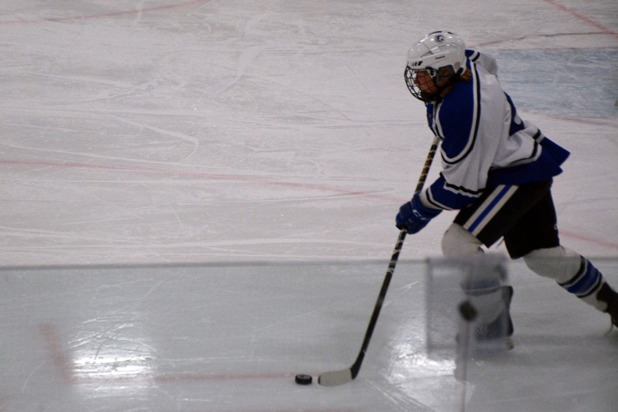 Sam Hylle skates the puck out of the defensive zone