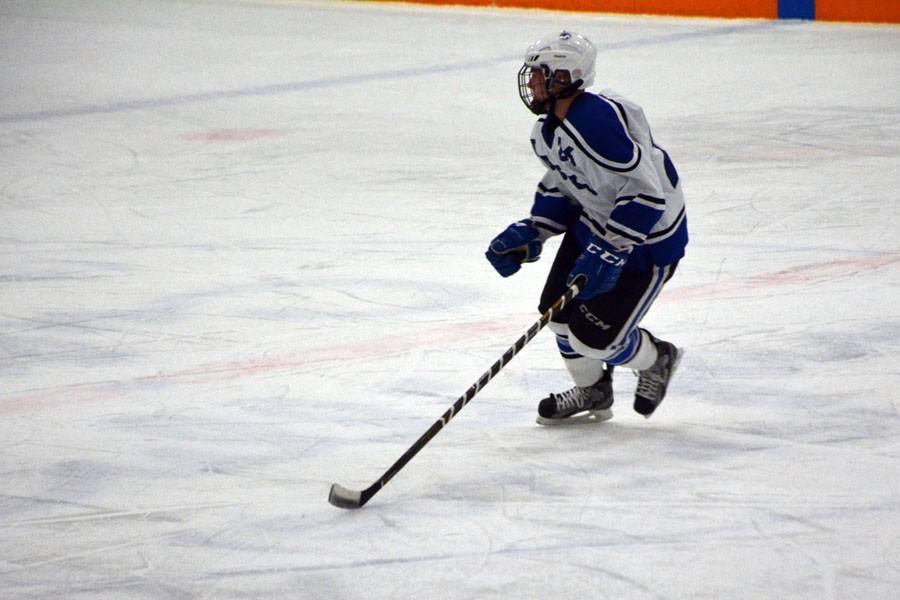 Mitchell Mayer skates in the neutral zone