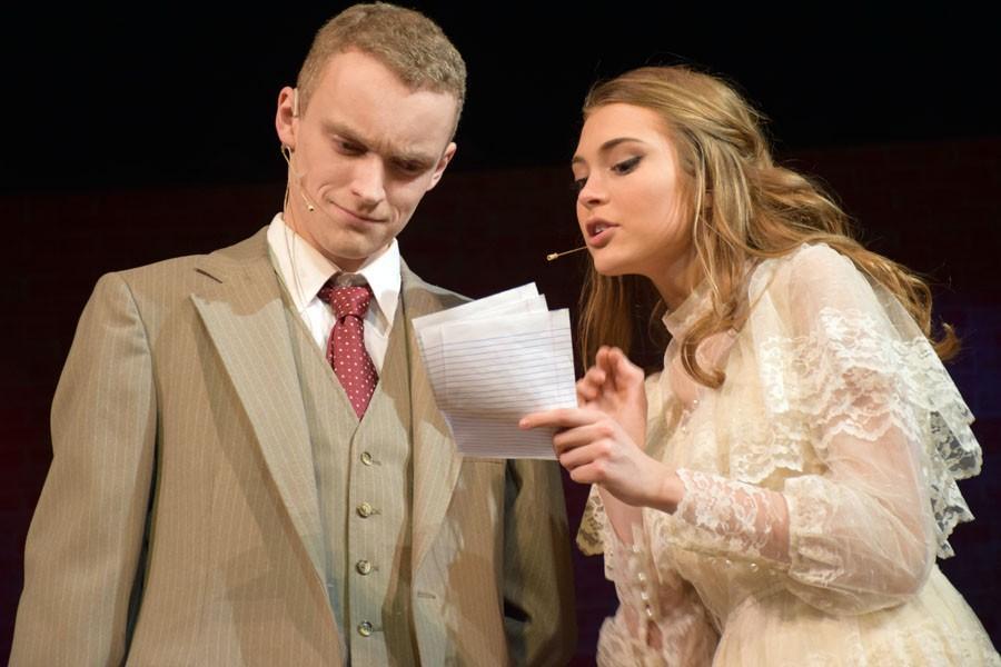 Lieutenant Frank Cioffi (Matt Reinhard) and Niki Harris (Jenna Rhoades) looking at death threats