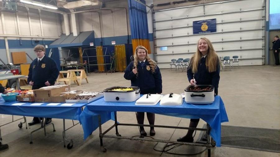 Junior Greg Weegman, senior Mariah Kane, and eighth grader Lanie Reick serving food at the appreciation breakfast