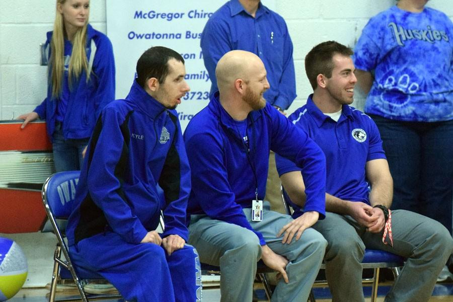 Head coaches C. W. Wolfe, John Scheil and Assistant coach Kyle Burns