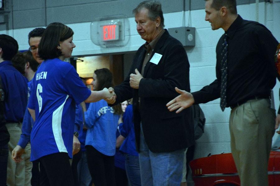 Taylor Hagen shaking Owatonna Mayor Kuntzs