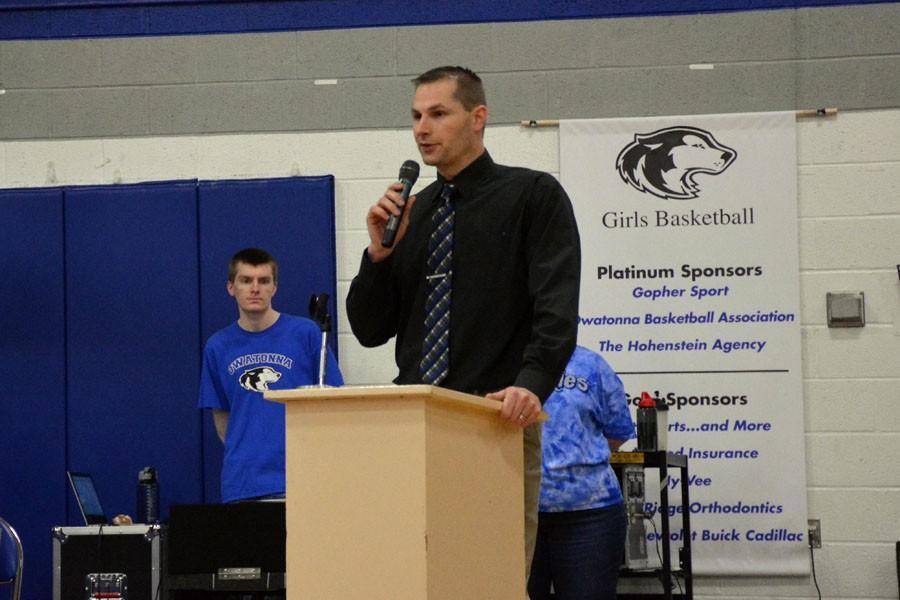 Activities Director Ryan Swanson congratulating the team