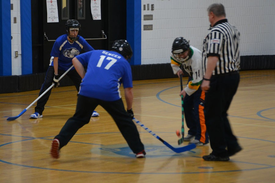 Zach Sencer taking the face-off and Alex Burns waiting for the pass