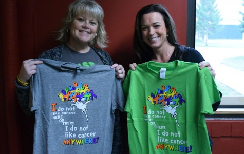 Mrs. Margo McKay and Mrs. Nancy Williams display pre-race t-shirts for the From the Heart Run