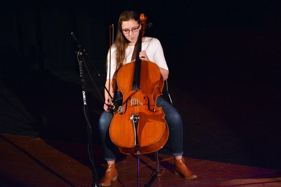 Freshman India Enter playing the Cello while freshman Jazz Palmer sings