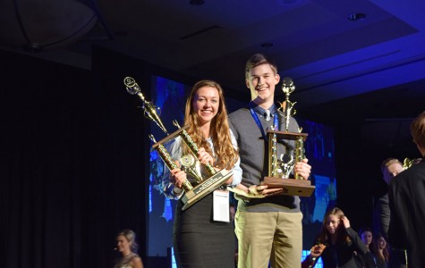 Lydia Anez and Luke Holzerland receive the second place trophy for their role play.