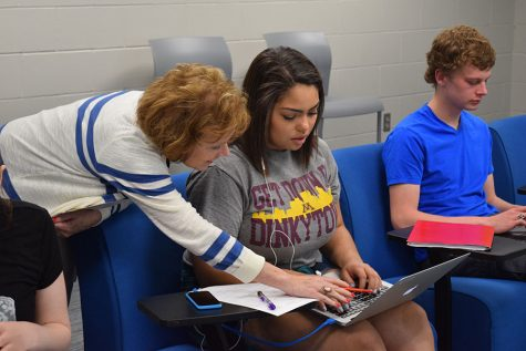 Mrs. Val Rose works with senior Kiana Smith on her mentorship project