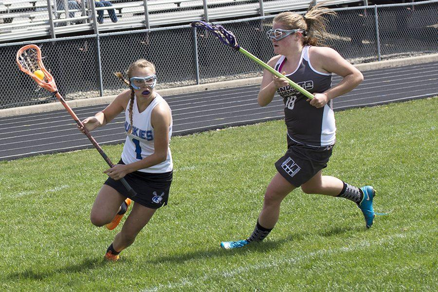 Sophomore, Kenna West runs the ball down to the attacking zone.