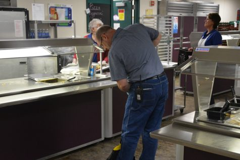 Janitor Kyle Granowski keeping the cafeteria clean in between lunches