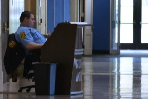 CSO Travis Johnson watching the cameras at the security desk