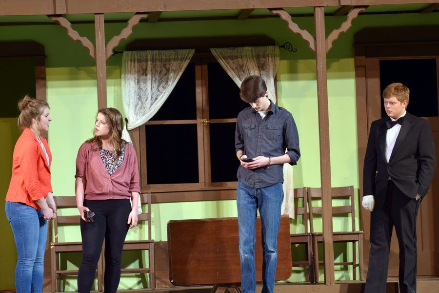Taylor (Ellie Boisen) arguing with Lila while Steve (Jacob Wright) keeps on texting