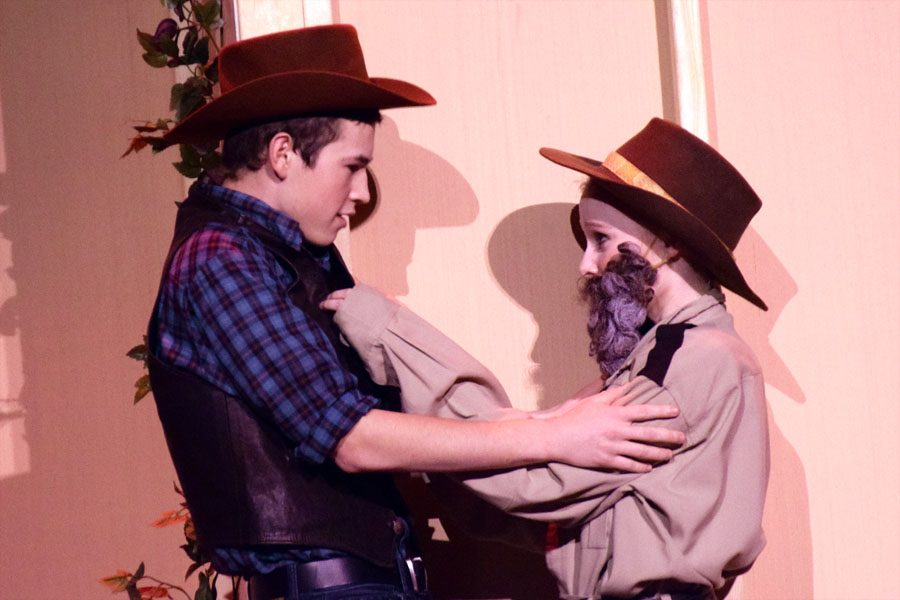 Tristan (Ryan Huxford) and Masha (Kjerstin Anderson) kissing backstage before the show