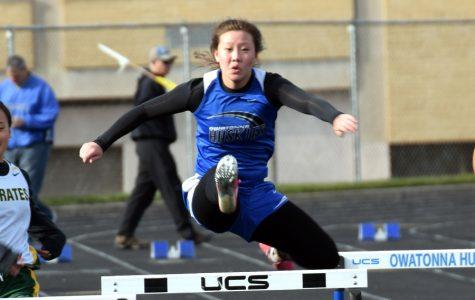 Junior Callie McCauley hurdling in the meet