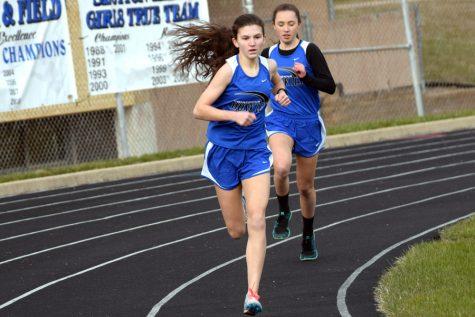 Freshman Emily Rahrick running in the meet