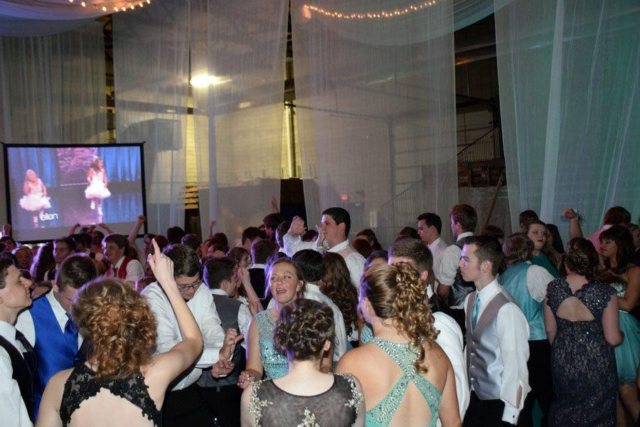 Students dancing on the dance floor at prom