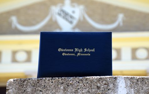 OHS graduates receive their diploma as a sign of the end of high school