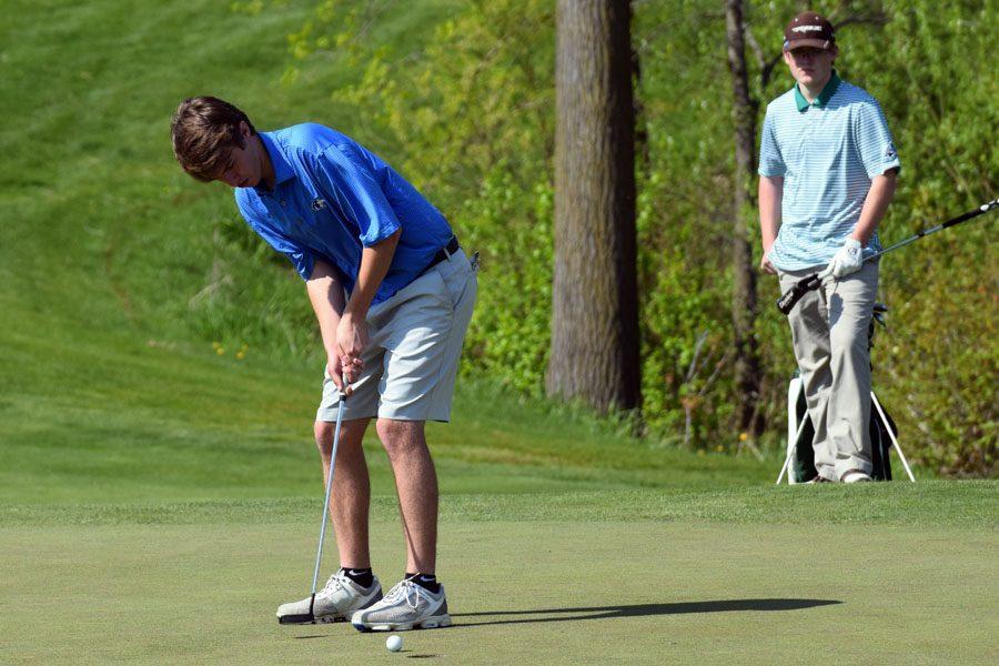 Sophomore Mac Baumgartner putting the ball