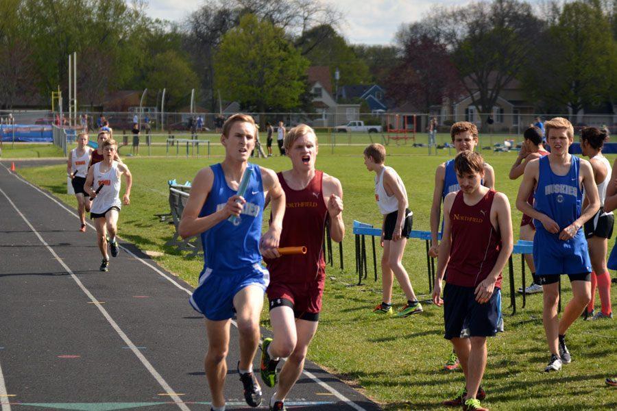 Junior Braydon Kubat running the relay race