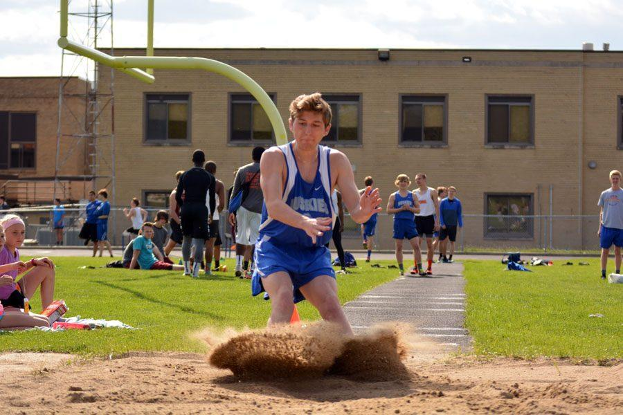 Sophomore Journey Peterson doing the long jump