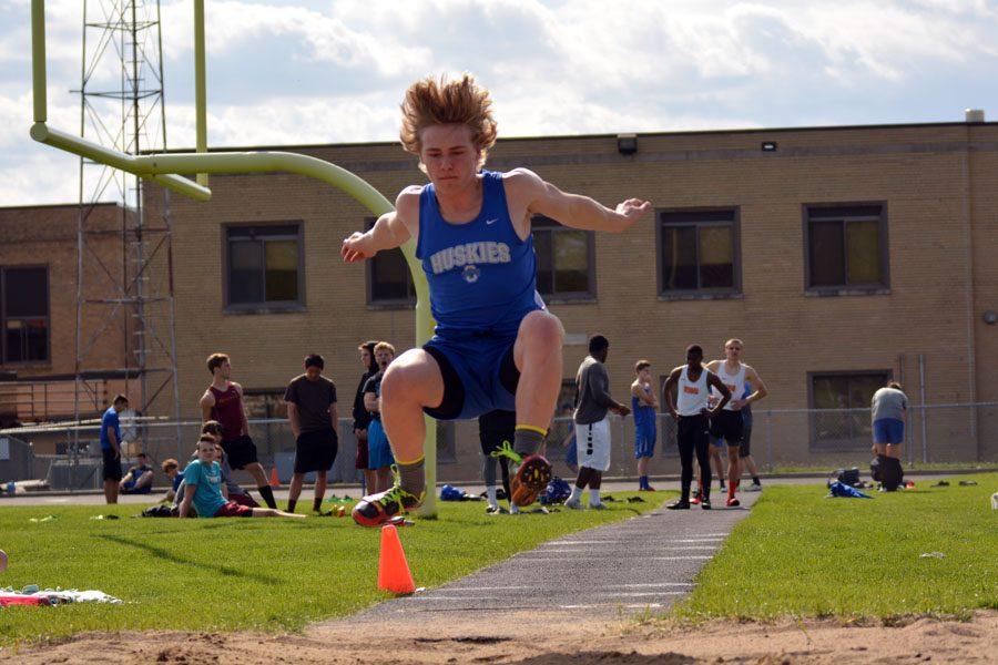 Junior Bryce Goodwin doing the long jump