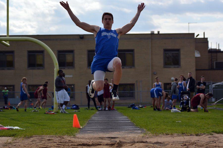 Senior Jake Borchert doing the long jump