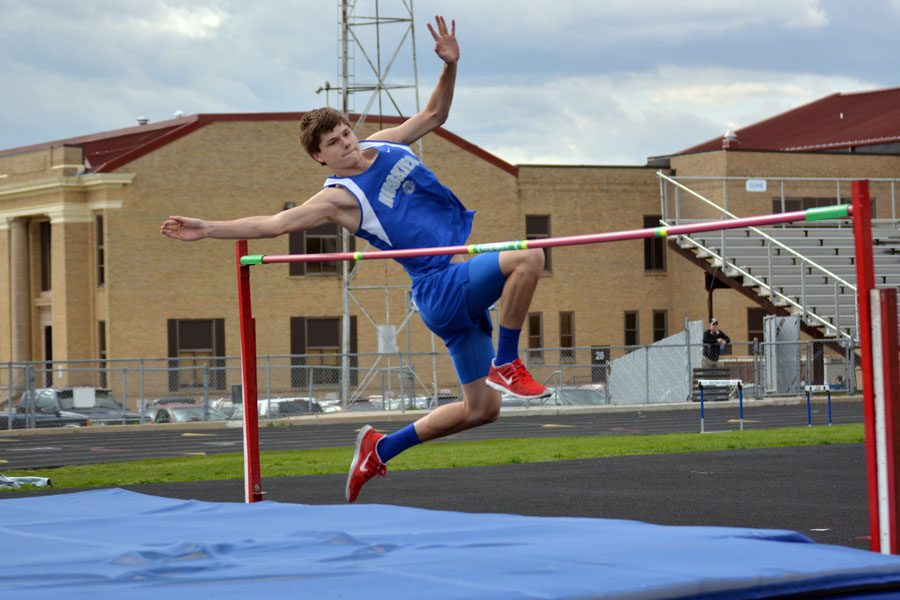 Sophomore Dalton Kubista doing the high jump