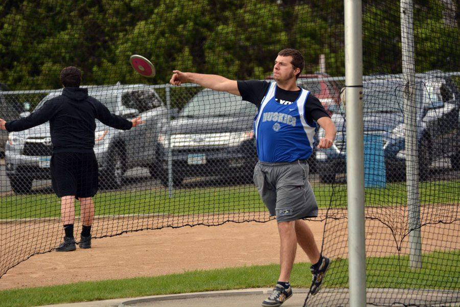 Junior Ryan Bos throwing Discus