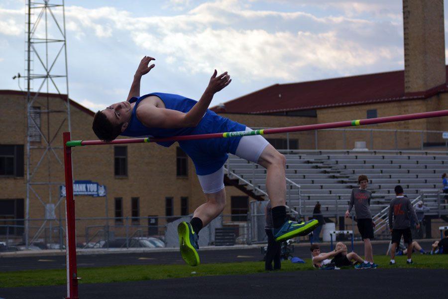 Senior Jake Borchert doing the high jump