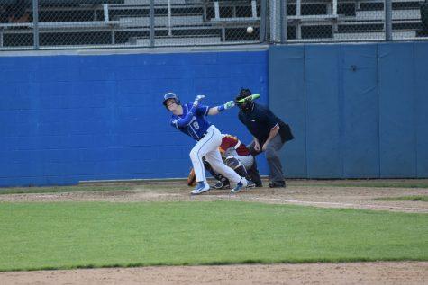 Kodey Kiel hits the ball to left field