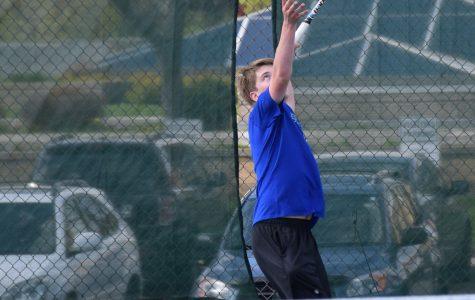 Boys Tennis making a racquet