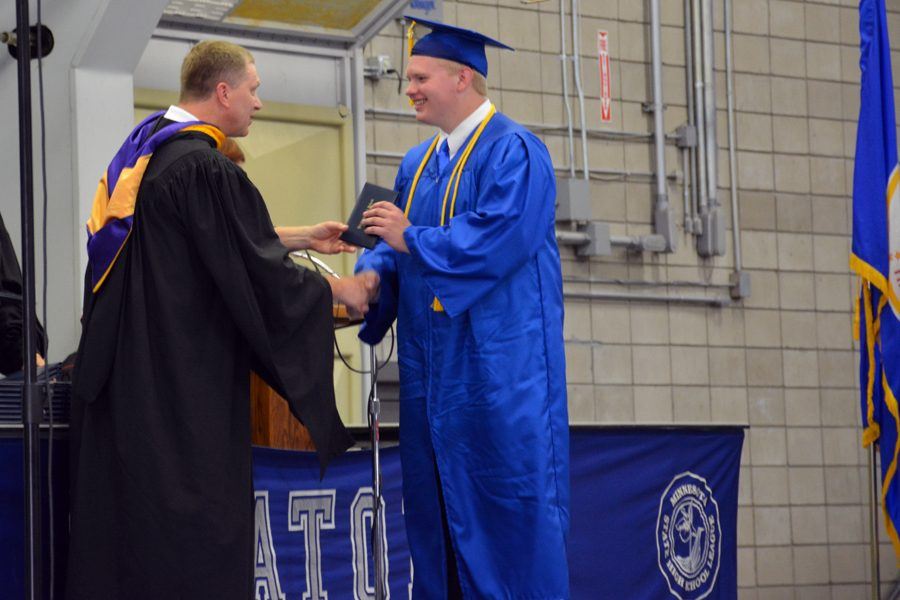 Senior Lucas Arndt receiving his diploma